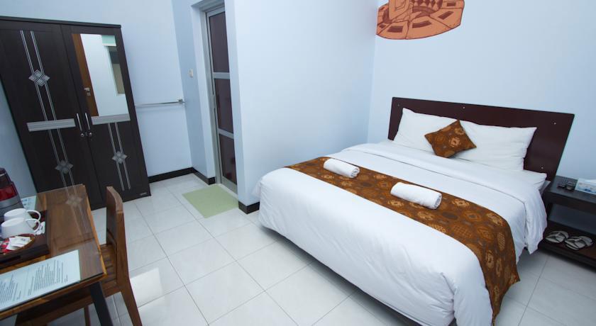 Suasana Kamar Hotel Amelia. Sumber: booking.com