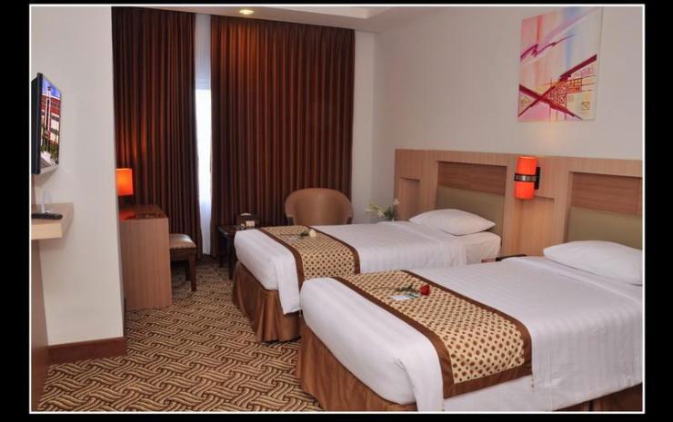 Kamar Hotel Abadi. Sumber: traveloka.com