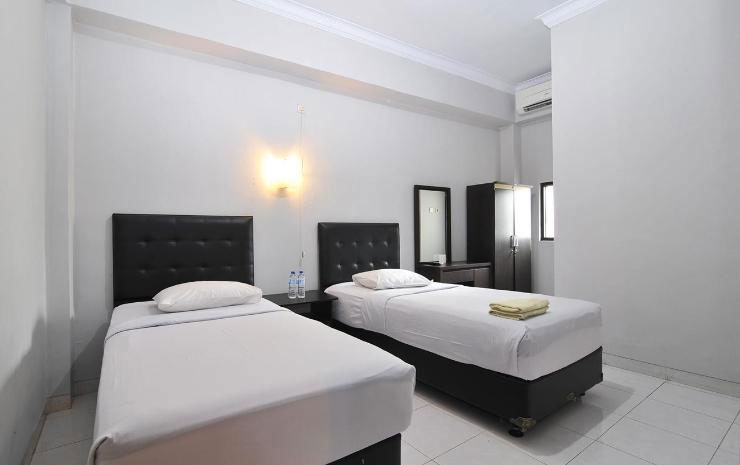 Suasana Kamar Campus Inn. Sumber: traveloka.com